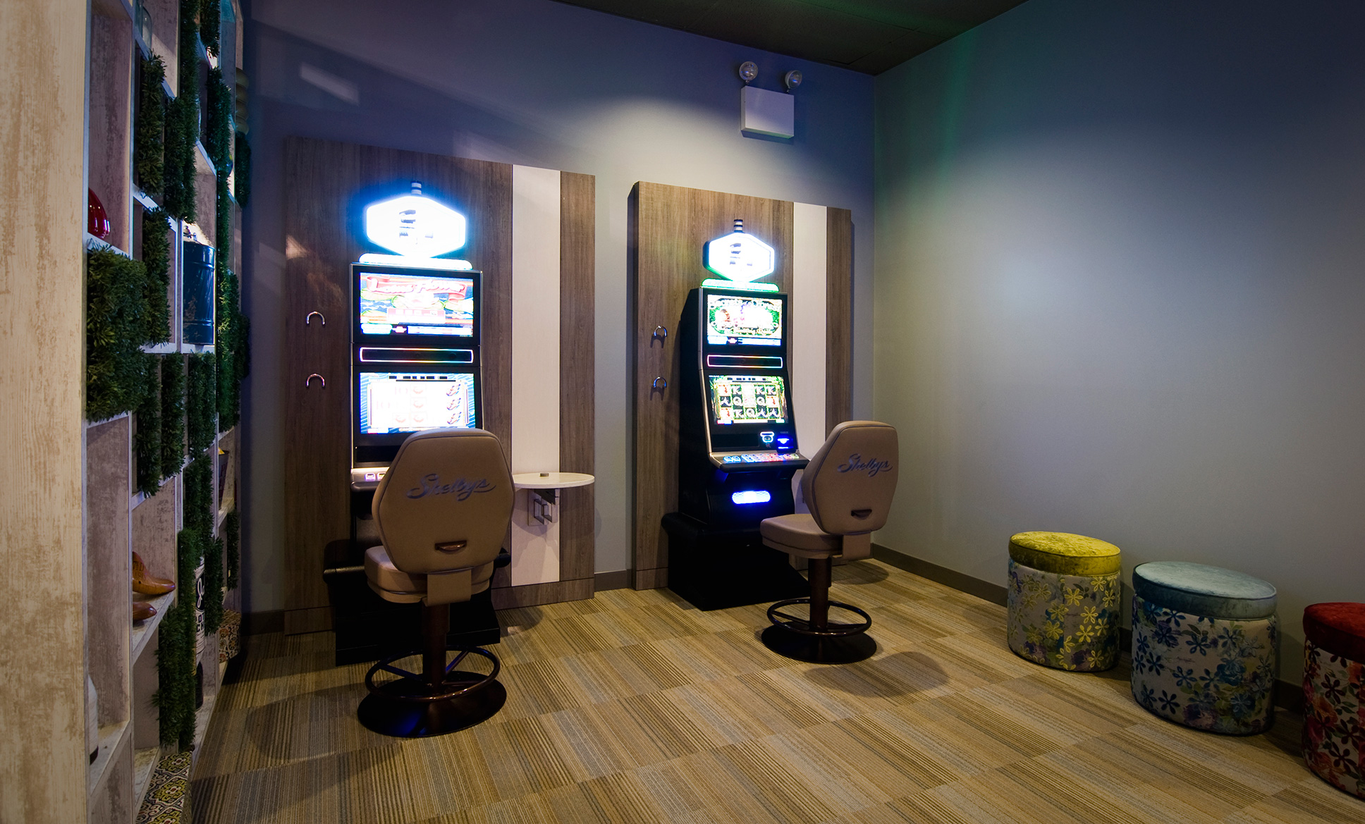 Bright lit slot machines and Shelby's branded leather chairs.