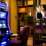 Glowing slot machine in front of modular shelving